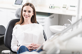 Smiling woman in dental office