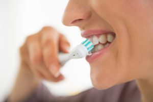 brushing teeth to keep up with dental hygiene through quarantine