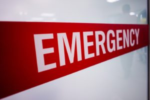 red and white emergency sign on white background