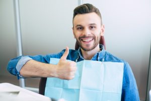 Man at dental appointment to maximize insurance benefits