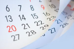 Pages of calendar to illustrate timeline for Invisalign in Woodbridge