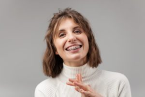 Smiling woman with braces as an adult in Woodbridge
