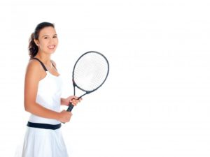 Young woman with orthodontics in Woodbridge holding tennis racket